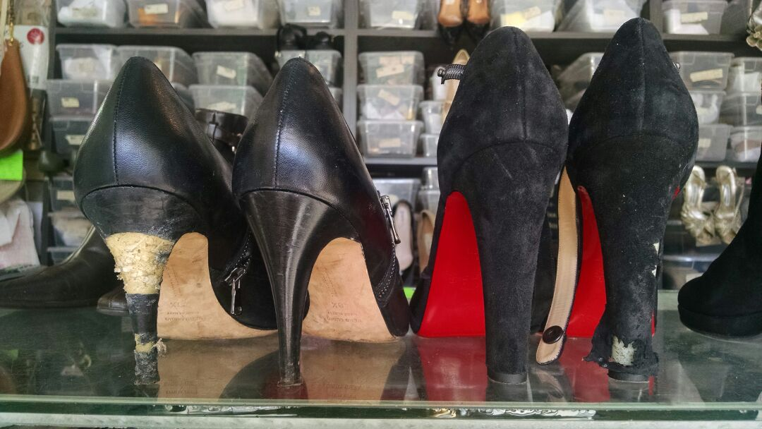 Two pairs of women's high heels that came in torn to shreds after Fido was done with em - BEFORE